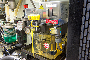 An Azbil TA's mist lubrication unit, incorporated into a machine tool, sprays lubricant on a spindle and bearing.