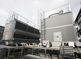 Cooling towers for freezers and refrigerators on the roof of the market.