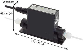 Figure 1. Model F7M micro-flow meter developed by Azbil. The white tubes are the inlet and outlet (left and right respectively) of the flow path. The black cable is for the power and signal lines.