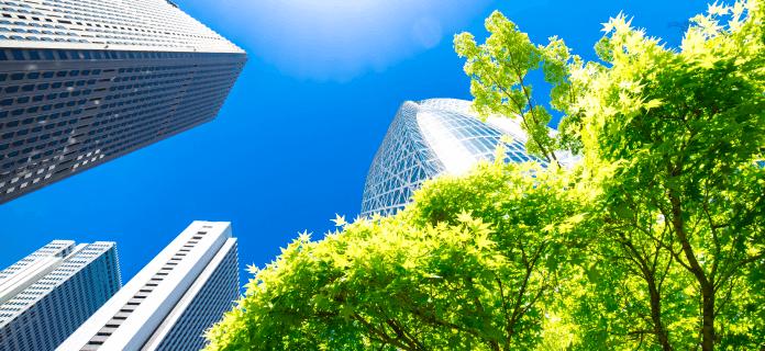 Contributing to a sustainable society<br>(ビルとエコ、先進の建物とグリーンのイメージの画像)